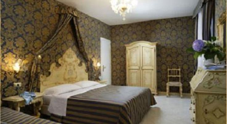 Hotel San Giorgio Venice Hotel San Giorgio is set in the heart of Venice, next to Teatro Rossini. It is in the same Gothic building as the Fortuny Art Museum.  All of the guest rooms at the San Giorgio Hotel overlook peaceful, Venetian lanes.
