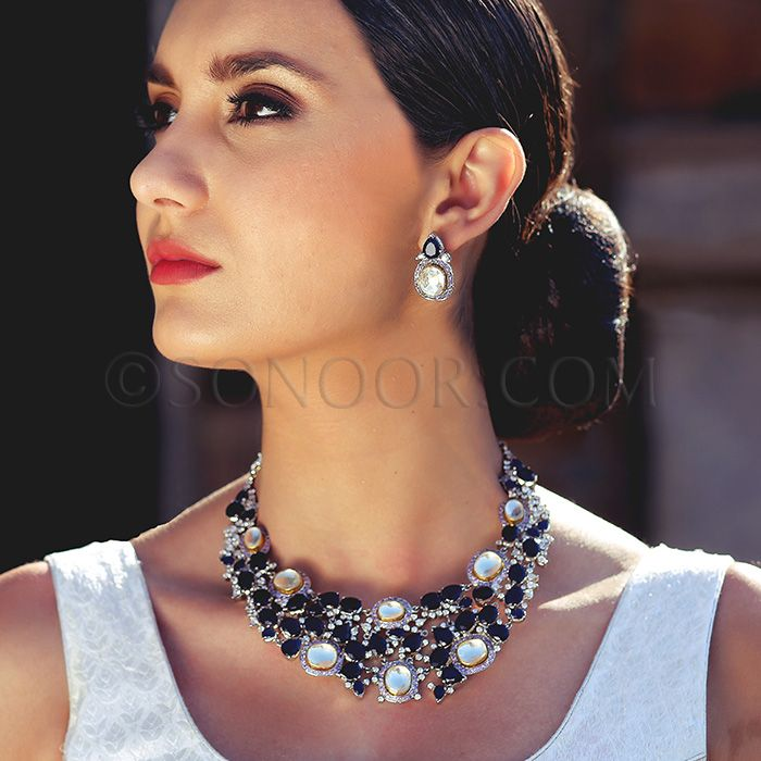 NEC/1/3710 Oshini Necklace Set with Earrings in silver rhodium finish studded with blue iolite, cubic zircons, and kundan stones