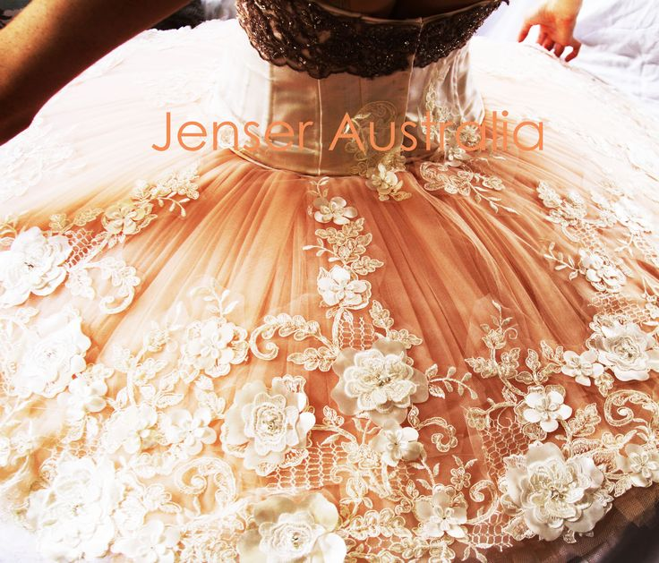 Layers of hand pleated blush pink tulle  stunning ivory lace applique  .