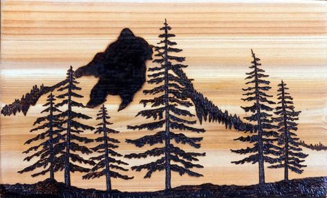 """Hand crafted wood burned (pyrography) Mountains and Pine forest scene I have used the art of pyrography to wood burn my original Mountain & Pine Landscape abstract design on to a natural Red Cedar wood block which measures 11 6/8"""" x 7 1/8"""" x ¾"""" thick. The beautiful natural luster of the"""