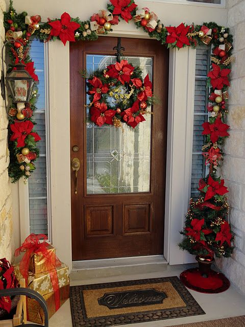 Front door is similar in shape/size, could drape garland like this instead of straight across