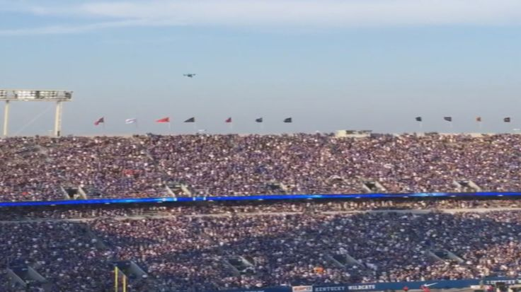 """Video Shows Drone Before Crash at Kentucky Football Game - NBCNews.com - September 6th, 2015 - """"The Mosquito Drone says: (BzZzZzzZzZzzzzzZzz. E.T.? There's a virus that has deflated my cousins in the United States. They're programmed to attack humans now lol lol lol. Hmmmm? I smell Edward Snowden & Vladimir Putin behind this) The Oil Rig says: (DUCK, HARRY, THERE'S ONE COMING STRAIGHT AT YOU O_O. RUN HARRY, RUN. lmao =))"""""""