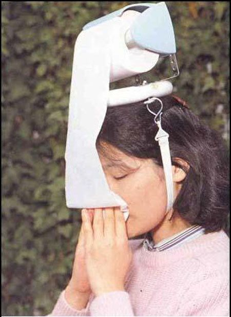 "from Strange Hats From Around the World.   It's good for allergy season.   ..... ever wonder what kind of ""stuff"" some people are on to have dreams that result in this kind of thinking??"