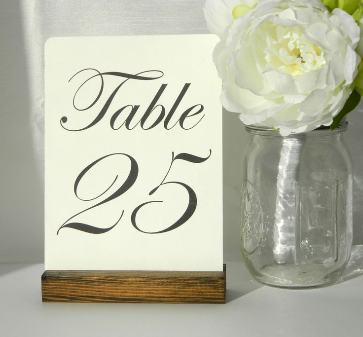 Rustic wood table number holders. Size: 5 inches long Finish: Dark Walnut Rustic wooden table card holders. Perfect for your rustic chic wedding, dinner party, bridal showers, or any rustic themed eve