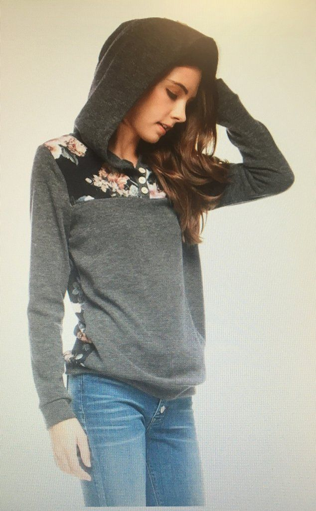 The Victoria Long Sleeve Floral Hoodie. Light Weight Sweater. Floral Design on Top Front and Whole Back of Shirt. Three Wooden Buttons on the Front. Flowers are a Pretty Mix of Burgundy, Blue and Tan.
