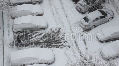 Car parking - people who clear snow from the cars and parking.