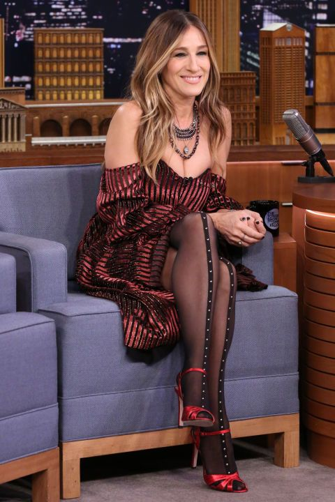 23 November Sarah Jessica Parker looked stylish in a striped off-the-shoulder dress which she wore with studded tights and bright red sandals for an appearance on a talk show in New York.