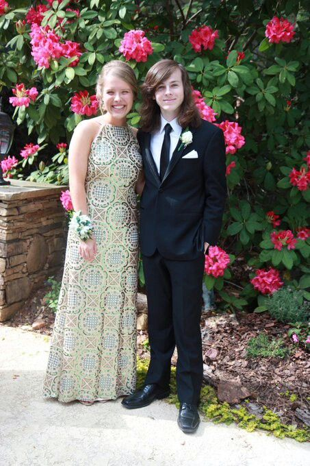Chandler riggs and his childhood friend going to senior prom