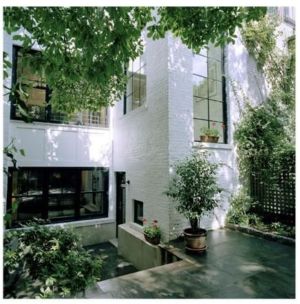 Love the white painted brick, metal windows, and greenery