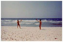 Luigi Ghirri - Lle Rousse - vintage photograph, people in bathing suits on the beach - matthew marks gallery     1976     From the series Kodachrome     Vintage c-print     7 1/2 x 11 3/8 inches; 19 x 29 cm
