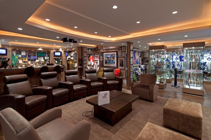 """Great """"Man Cave"""" ideas.   Room filled with an array of sporting memorabilia!"""