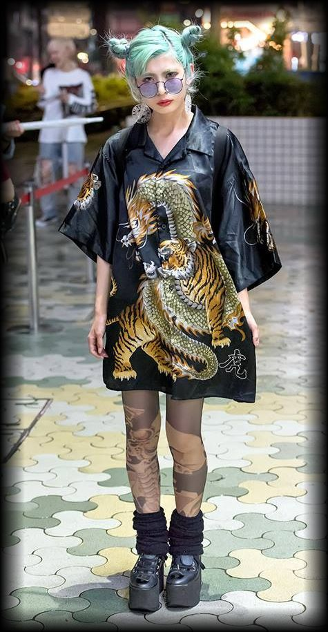 Ena on the street in Harajuku wearing a dragon vs tiger shirt dress from Dog Harajuku, Bubbles Harajuku shorts, Avantgarde (アバンギャルド) tights, Tokyo Bopper platforms, MYOB earrings.