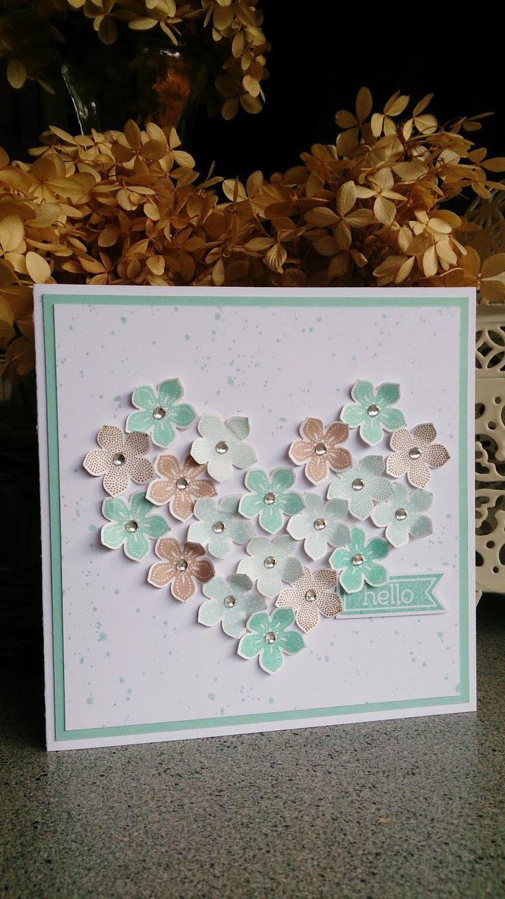 Stampin' Up! ... handcrafted card: Hello ... punched flowers form a heart ... jewel centers ... luv the texture from curling petals ....