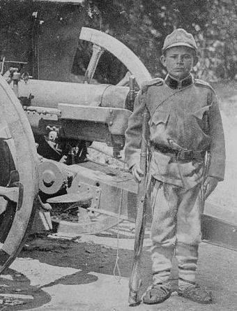 1915 - A 12-year-old Serb assists at an artillery battery in Belgrade.