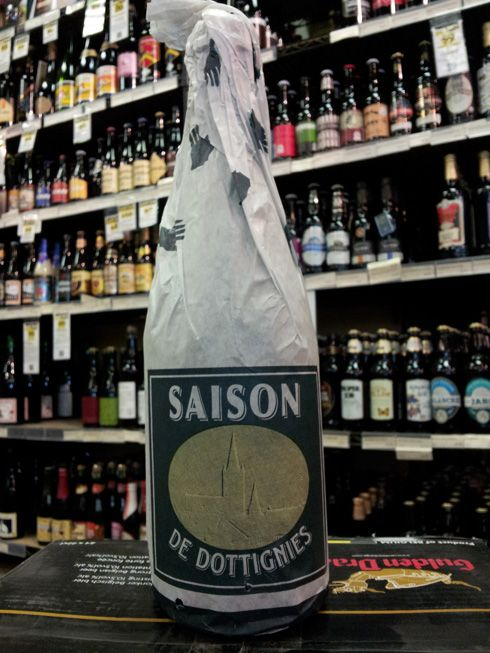 De Ranke Saison De Dottignies  http://www.kensingtonwinemarket.com/products/details.php?i_id=17302  De Ranke is a Saison brewery that especially built their brewery to use whole hop flowers in their beers. Many of their beers are blends with lambics, but this one is a straight saison. It has a yeasty aromas, with citrus, malts, and flowery hops. These aroma characters are also present in the flavour to make a well balanced palate.