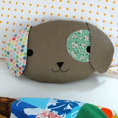 Children love cuddling up to a special pillow at home or in the car, and this cute puppy with his floppy ears and an eye patch could easily become a new favourite. Especially as it's handmade with love. | Difficulty: Intermediate; Length: Medium; Tags: Sewing, Babies and Kids, Felt, Fabric, Sewing Machine, Fusible Web