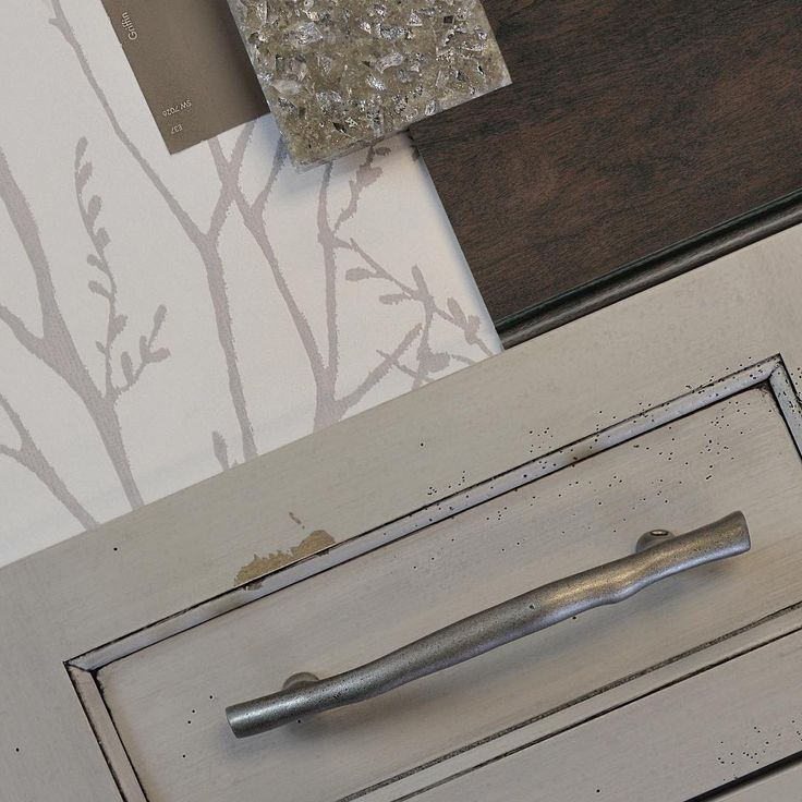 """Nature Inspired Interior Design: This kitchen & bath design idea combines the following finishes; The """"Highland Panel"""" cabinet door style in Heritage Paint """"H"""" from Dura Supreme with a Caraway stain sample on Cherry wood from Dura Supreme #Cabinetry, Top Knobs Aspen Collection Twig Pull, Sherwin-Williams Griffin, Cambria """"Minera"""" and Brewster Home """"Delamere Pewter Tree Branches"""" Wallpaper. See more at @durasupreme on #Instagram"""