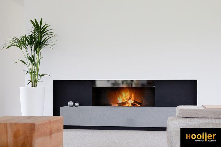 Deze M-design Luna 1150 H is opgeleverd in een op maat gemaakt stalen design kader. In een strakke wand zorgt het maatwerk Belgisch hardstenen plateau voor een robuuste uitstraling. Deze multifunctionele hout inbouwhaard kan zowel gesloten als open gestookt worden.