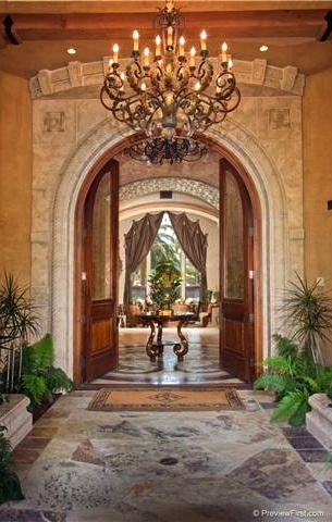 ~ Arched doorway, stone flooring, chandelier