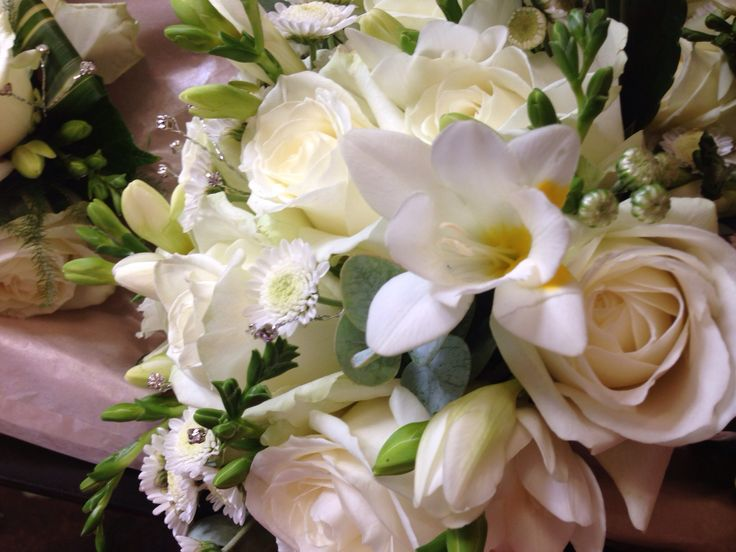 Close-up of a bridal bouquet with freesia and roses