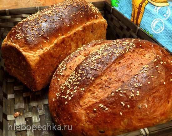 Хлеб с овсяными хлопьями, отрубями, кунжутом и семечками  овсяные хлопья длительной варки50г  отруби20г  кунжут15г  семечки (подсолнечника, льняные, тыквенные)15-20г  кипяток250мл  кефир (кислое молоко, простокваша, сыворотка)100мл  дрожжи прессованные15г (5г сухих)  сахар2 ст.л.  мука пшеничная 1с300-340г  соль7г  масло сливочное (смалец)15г