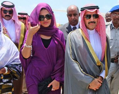 Prince Al-Waleed bin Talal Bin Abdulaziz Al-Saud, right, nephew of King Abdullah of Saudi Arabia, and his wife, Princess Ameera al-Taweel, left, on their arrival in Mogadishu, Somalia, in August of 2011