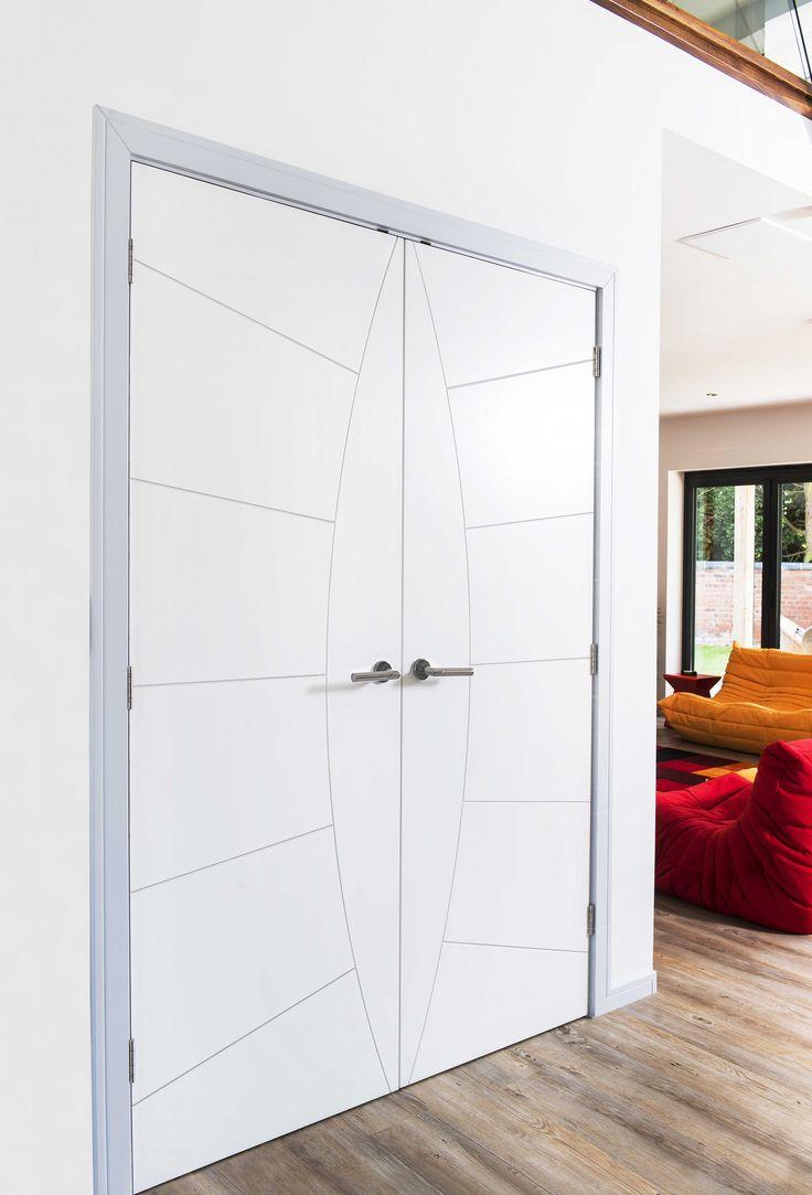 Stunning white double doors with attractive grooved design. JB Kind's Limelight Elektra door design.
