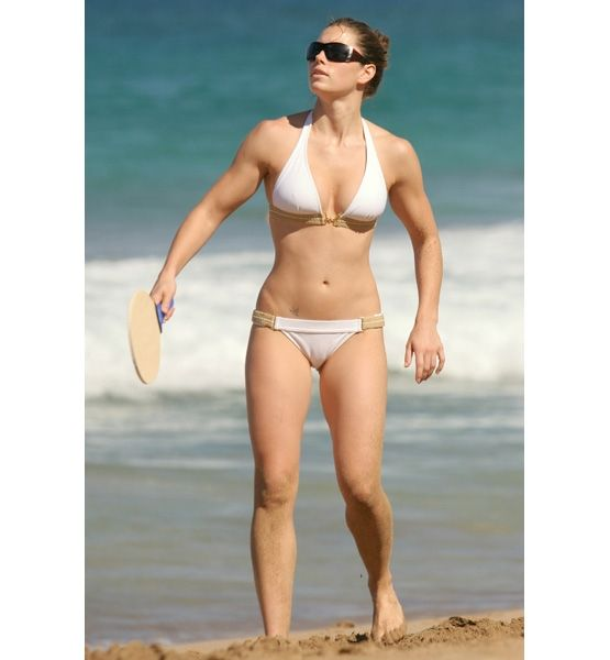 not stick skinny, but tone, fit, and refreshing. i admire the fact that she embraces her shape and strength.