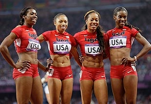 Image: (From left) Francena McCorory, Allyson Felix, Sanya Richards-Ross & Deedee Trotter celebrate after winning the gold medal on Saturday (© Anja Niedringhaus/AP)