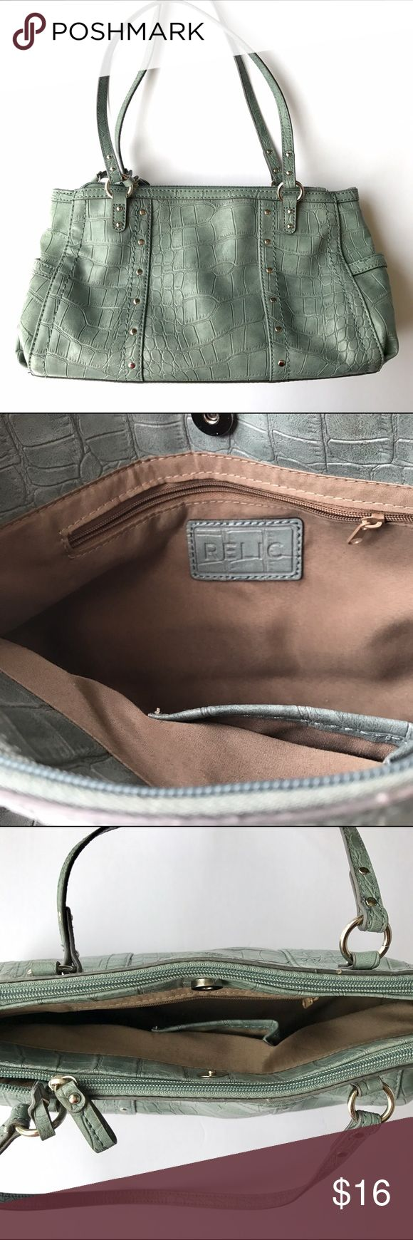 Relic elegant textured purse A lovely shoulder bag with several pockets inside and outside. The color is a pastel green blue - I would describe it as mint colored. Crocodile style texture on the outside. Lined inside with many compartments. Stylish purse for everyday use. Relic Bags Shoulder Bags