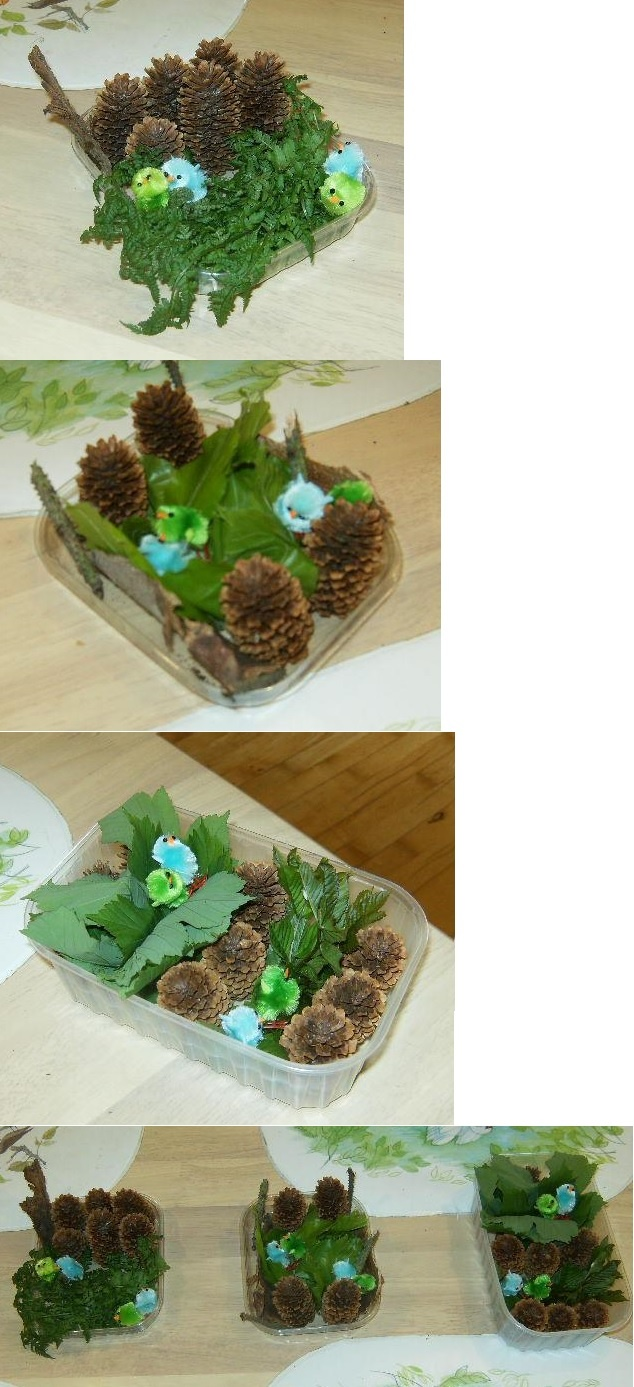 Flower decorations with green and blue chickens in them.