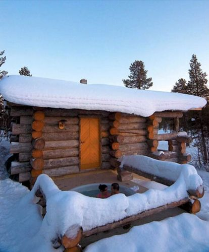 One tip for installing a year-round hot tub? Place it as close to a door to inside as possible. Building onto the side of a rustic log cabin doesn't hurt either.