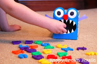 Feed The Monster Language Game. Fun for learning new sounds and it's all made from a Kleenex box and construction paper!