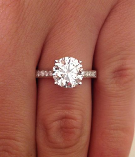 I love the solitaire rings. A 2 carat diamond and a delicate band are all a girl really needs