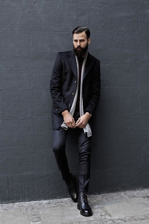 Nail that dapper look with a black overcoat and black suit pants. Rock a pair of black leather brogue boots for a more relaxed aesthetic.  Shop this look for $290:  http://lookastic.com/men/looks/brogue-boots-dress-pants-overcoat-scarf-crew-neck-sweater/7992  — Black Leather Brogue Boots  — Black Dress Pants  — Black Overcoat  — Grey Scarf  — Burgundy Crew-neck Sweater