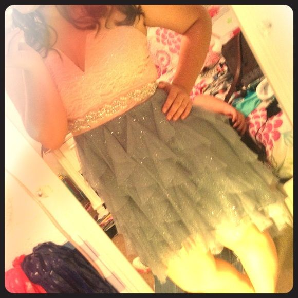 Homecoming/prom soft pink and grey dress Strapless nude pink top with glitter and sequins. Has a strapless v line.  Bottom part is sparkly grey with ruffle. It is is a high low dress. jcpenney Dresses High Low