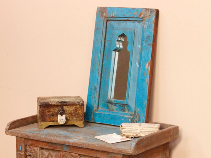 A lovely rusticblue wall mirror with a stunning blue paint-distressed surface finish. Its attractive ornate profile reflects its Northern Indian origin. #vintage #mirror #unique #furniture #homedecor #homestyle