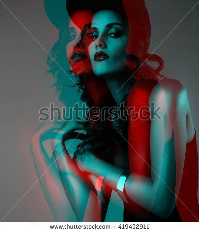 The three-dimensional picture of a beautiful sexy girl in a baseball cap, a black bathing suit with makeup and beautiful hands