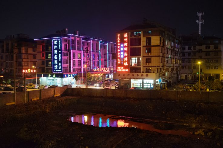 This Chinese Town Manufactures Almost Everything 'Made in China' - VICE Elizabeth Renstrom  Use of relflections and colour are striking