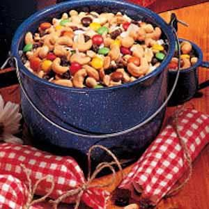 Trail Mix Recipe -With nuts, raisins, M&M's and coconut, this is a super snack. In small gingham bags, it made wonderful party favors for each guest at the cowboy-theme wedding shower I hosted. This mix is a tasty treat anytime. -Sandra Thorn, Sonora, California