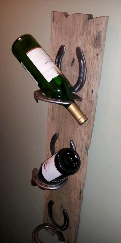 Rustic wine rack. made with horse shoes attached to old barn wood. Stores 3 bottles cork down. on Etsy, $60.00