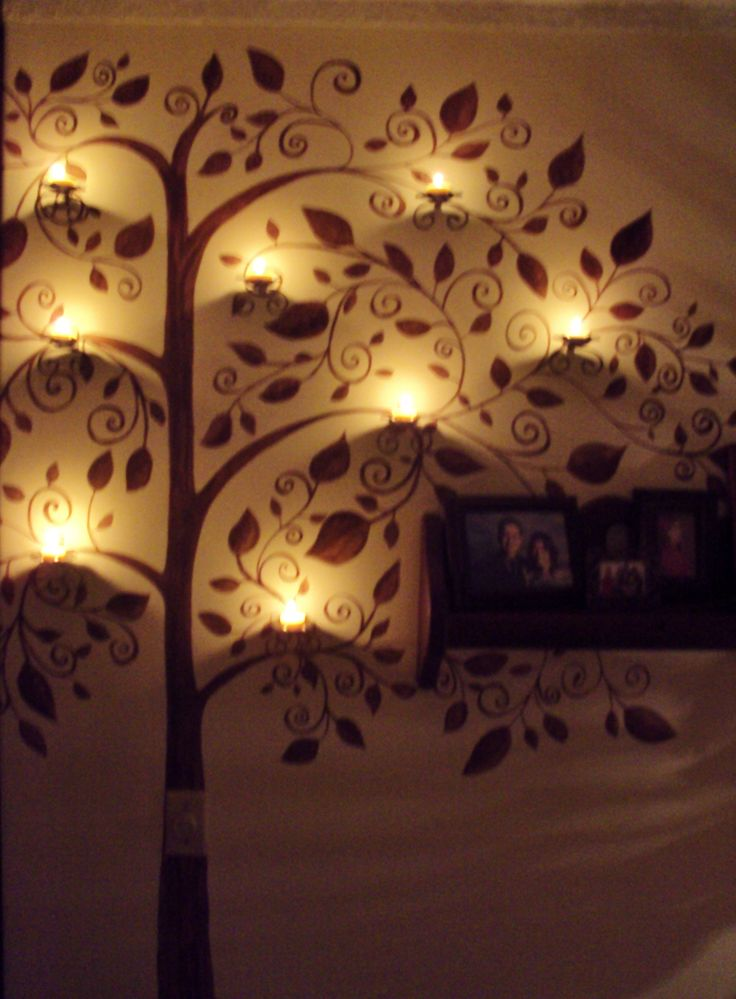 My Candle-tree. I painted a tree in the middle of my living room and put candles. I love it!