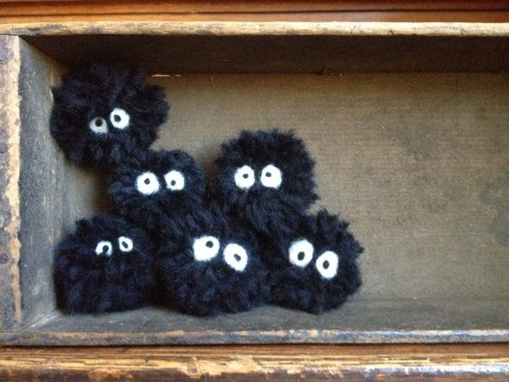 These are small soot sprites/gremlins, also known as susuwatari in the Studio Ghibli films My Neighbor Totoro and Spirited Away. They are made of