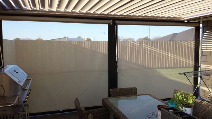 Outdoor Room looking inside out, with a Louvretec Opening Roof and Louvretec mesh shade blinds.