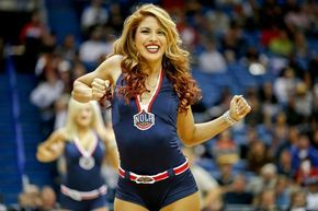 Dec 16, 2014; New Orleans, LA, USA; The New Orleans Pelicans dance team perform during the third quarter of a game against the Utah Jazz at the Smoothie King Center. The Pelicans defeated the Jazz 119-111. Mandatory Credit: Derick E. Hingle-USA TODAY Sports