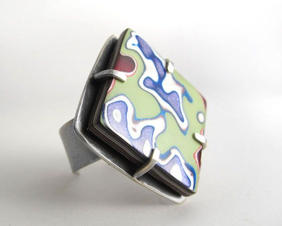 Holiday Delivery - Please click on the shipping and policies tab for information, especially if shipping outside the USA. UK buyers - Please scroll down and read important information regarding VAT before ordering A fun sterling silver and Fordite cocktail ring! It was fabricated by me