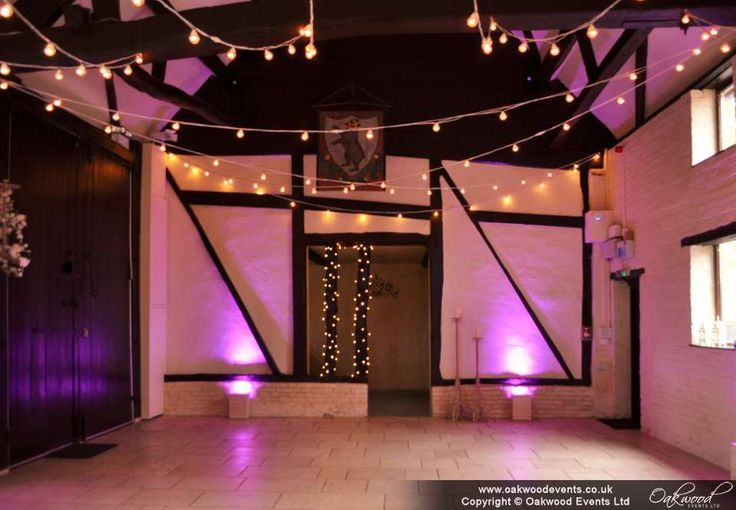 Barn festoon lights with pink uplighting at the Carriage Barn