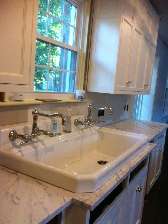 Kohler Utility Sink and Rohl Wall Mount Bridge Faucets, love the detailing on that sink