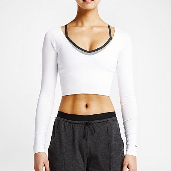 Nike Dry Fit Training Crop Top Very stretchy, new with tags but does have various dust marks, as seen in last photo. Nike Tops Crop Tops