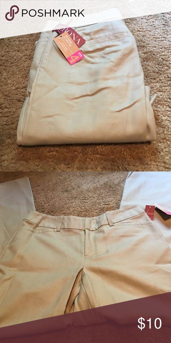 Mid waist and curvy hip merona dress slacks Fit 4 merona tan dress slacks, two clasp front with zipper, two back pockets with no buttons Merona Pants Trousers